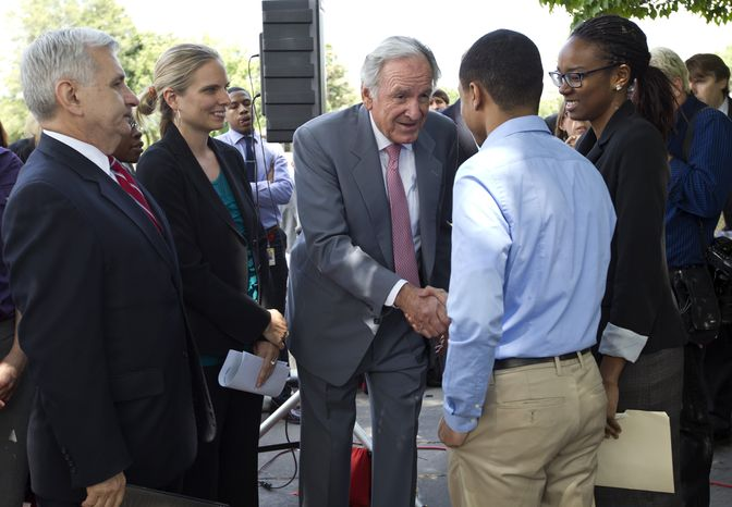 **FILE** Democratic Sens. Jack Reed (left), of Rhode Island, and Tom Harkin (center), of Iowa, meet June 6, 2012, with college interns on Capitol Hill in Washington as they call for action on averting a July 1 doubling of interest rates on federal college loans for students. (Associated Press)