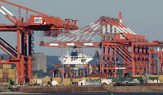 The container ship Ville D'Aquarius is docked at the Port Newark Container Terminal in Newark, N.J., on Wednesday, June 27, 2012. The U.S. Coast Guard suspects that stowaways may be in one of the containers on the ship. (AP Photo/The Jersey Journal, Reena Rose Sibayan)