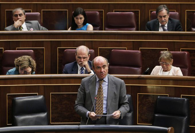 Spain's Economy Minister Luis De Guindos (bottom center) speaks June 27, 2012, during a control session at the Spanish Parliament in Madrid. (Associated Press)