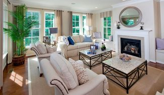 The main level of the Kiawah model has an open great room with windows on three sides and an optional fireplace.