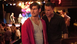 """This film image released by Warner Bros. shows Alex Pettyfer, left, and Channing Tatum in a scene from """"Magic Mike."""" (AP Photo/Warner Bros., Claudette Barius)"""