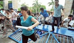 Parents stampede over a crashed gate May 12 at Thuc Nghiem primary school in a dash to grab coveted application forms for their children in Hanoi. The school is one of Vietnam's only public institutions emphasizing American-style instruction rather than rote memorization. Roughly 600 kindergartners from around the capital are vying for about 200 spots available this fall. (Associated Press)