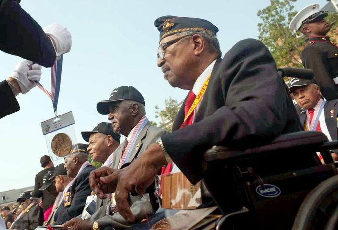 Raymond Thompson/The Washington Times Archibald Mosley awaits the awarding of his Congressional Gold Medal at a ceremony Thursday for about 400 retired black Montford Point Marines at Marine Barracks Washington. They served in segregated Marine units in the 1940s. <b>Gallery, washingtontimes.com/multimedia. </b>