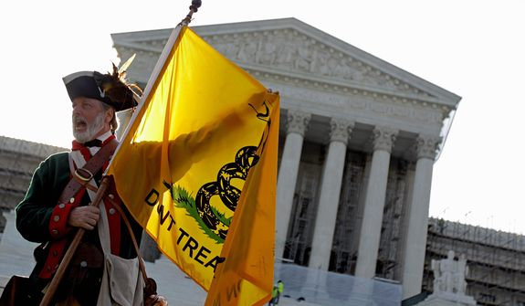 ** FILE ** Tea party supporter William Temple of Brunswick, Ga., on protests against the health care law outside the Supreme Court. Opponents vow to make the law an issue in this fall's presidential and congressional elections. (Associated Press)