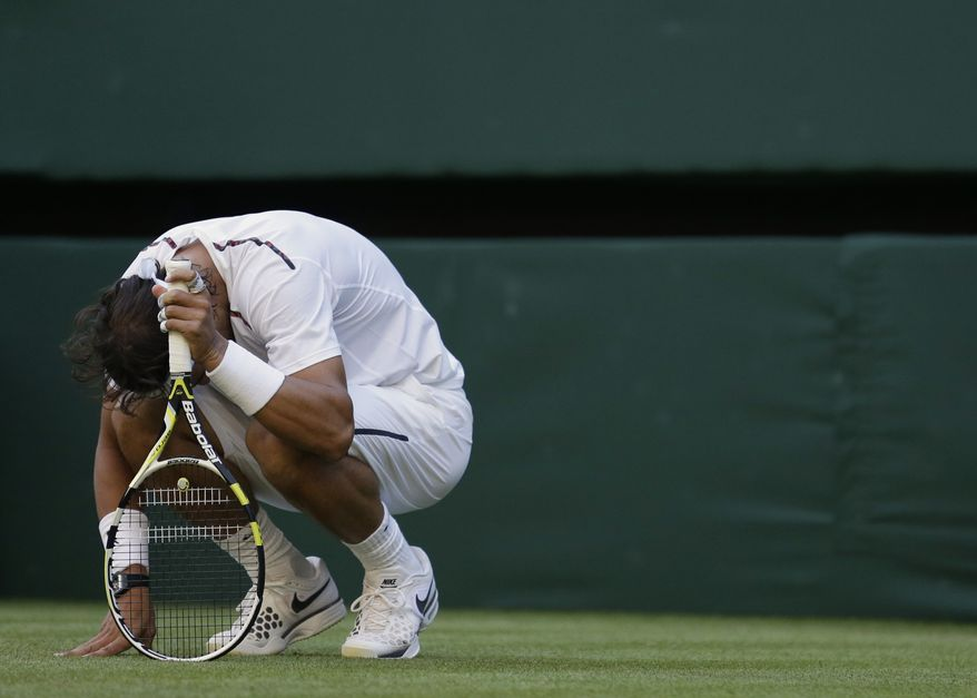 Rafael Nadal of Spain Lukas reacts after losing a point to Rosol of the Czech Republic during a second round men's singles match at the All England Lawn Tennis Championships at Wimbledon, England, Thursday, June 28, 2012. (AP Photo/Anja Niedringhaus)
