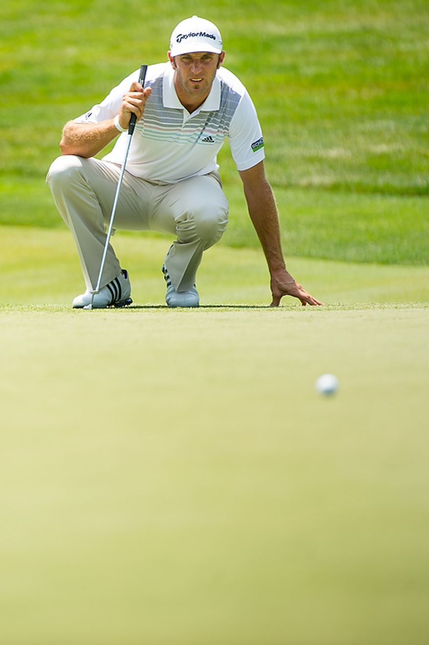 Dustin Johnson lines up a putt on the eighth hole on the first day of the AT&T National golf tournament held at Congressional Country Club, Bethesda, Md., Thursday, June 28, 2012. (Andrew Harnik/The Washington Times)