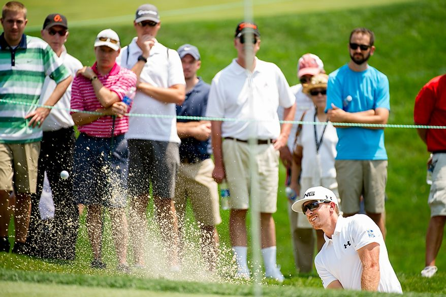 Hunter Mahan gets himself out of a bunker on the seventh hole on the first day of the AT&T National golf tournament held at Congressional Country Club, Bethesda, Md., Thursday, June 28, 2012. (Andrew Harnik/The Washington Times)