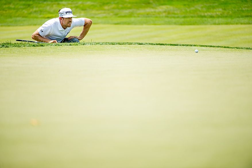 Hunter Mahan lines up a putt on the eighth hole on the first day of the AT&T National golf tournament held at Congressional Country Club, Bethesda, Md., Thursday, June 28, 2012. (Andrew Harnik/The Washington Times)