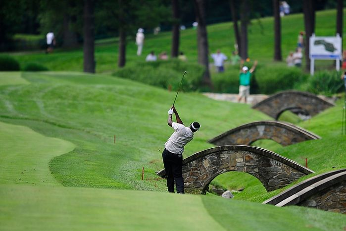 Vijay Singh hits an approach shot on the eleventh hole at Congressional Country Club during first round play of the AT&T National golf tournament, Bethesda, Md., Thursday, June 28, 2012.  (Ryan M.L. Young/The Washington Times)
