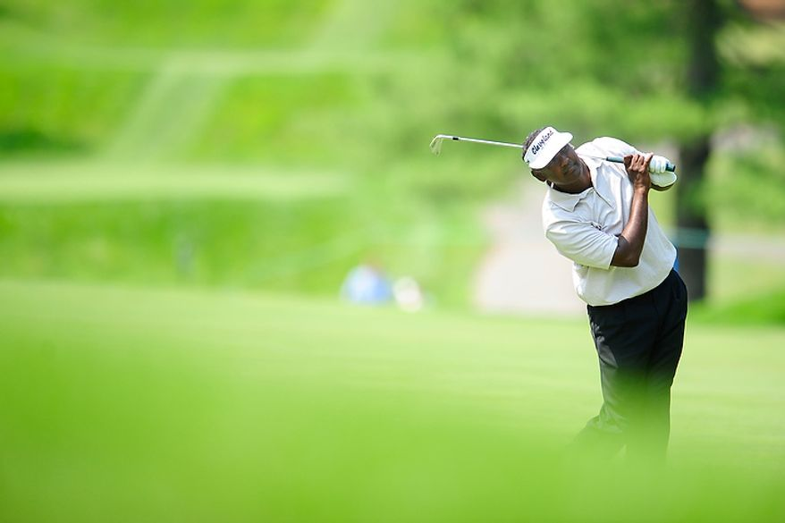 Vijay Singh watches his approach shot on the twelfth hole at Congressional Country Club during first round play of the AT&T National golf tournament, Bethesda, Md., Thursday, June 28, 2012.  (Ryan M.L. Young/The Washington Times)