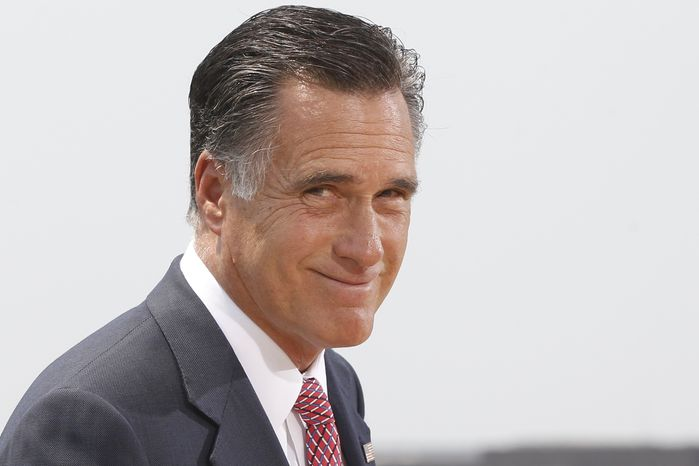 Republican presidential candidate Mitt Romney finishes speaking about the Supreme Court ruling on health care in Washington on June 28, 2012. (Associated Press)