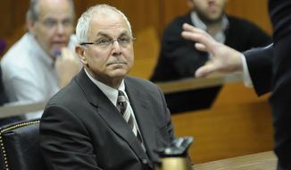 ** FILE ** Peter Madoff, brother of Bernard Madoff, attends a court hearing in Mineola State Supreme Court in Mineola, N.Y., on April 3, 2009. (AP Photo/Louis Lanzano, Pool)