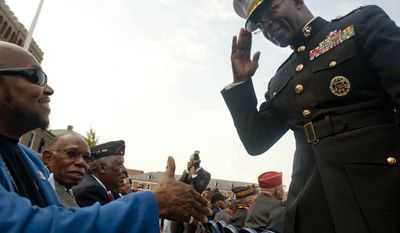 Maj. Gen. Ron Bailey (cq) salutes retired Marine Corp members during the Montford Pointe Marines Parade at the Marine Barracks Washington on Thursday, June 28, 2012, in Washington D.C. Approximately 20,000 African American Marine recruits where trained at Montford Pointe when the military was still segregated. The serving members received the Congressional Gold Medal for their service. (Raymond Thompson/The Washington Times)