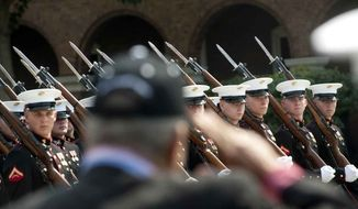 U.S. Marines parade at the Marine Barracks in Washington on Thursday, June 28, 2012. (The Washington Times)