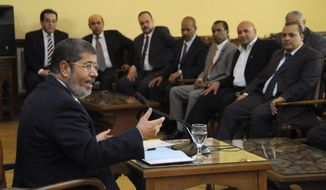In this photo released by the Egyptian Presidency, President-elect Mohammed Morsi speaks with representatives from political parties in Cairo, Egypt, Thursday, June 28, 2012. (AP Photo/Egyptian Presidency)