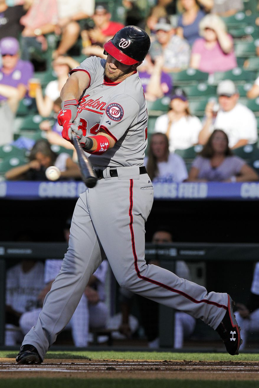 Bryce Harper had two of the Washington Nationals' 14 hits in their 11-5 victory over the Colorado Rockies on Wednesday night. (AP Photo/Barry Gutierrez)