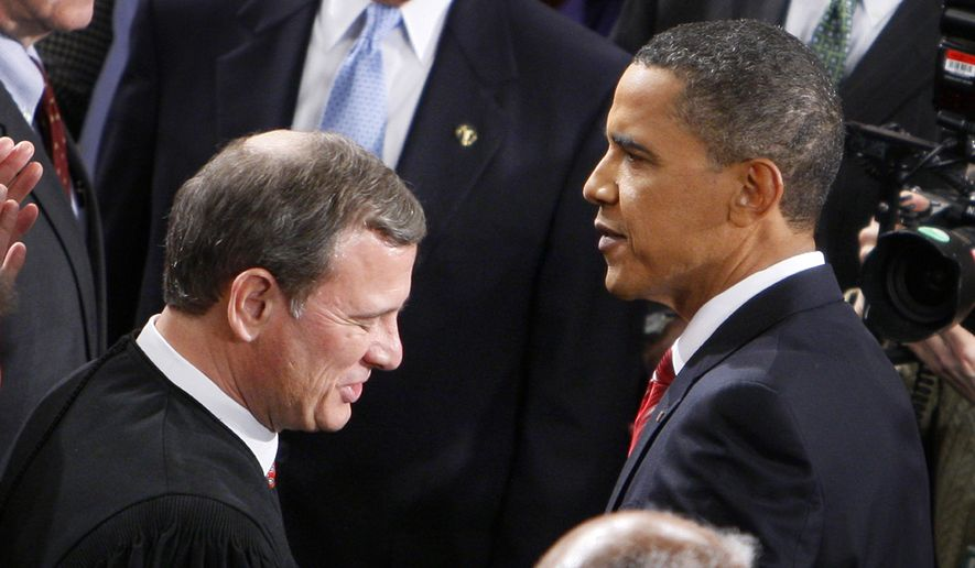 President Obama greets Chief Justice John Roberts on Jan. 27, 2010, before he delivered his State of the Union Address on Capitol Hill in Washington. (Associated Press) **FILE**