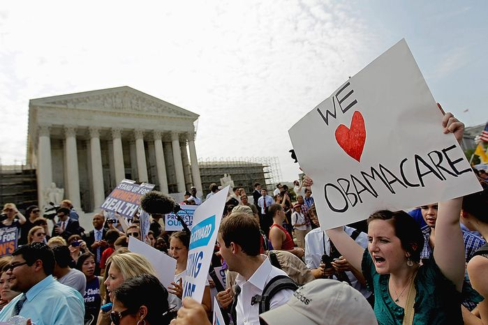Supporters of President Obama's health care law celebrate outside the Supreme Court in Washington on June 28, 2012, after the court's ruling was announced. (Associated Press)