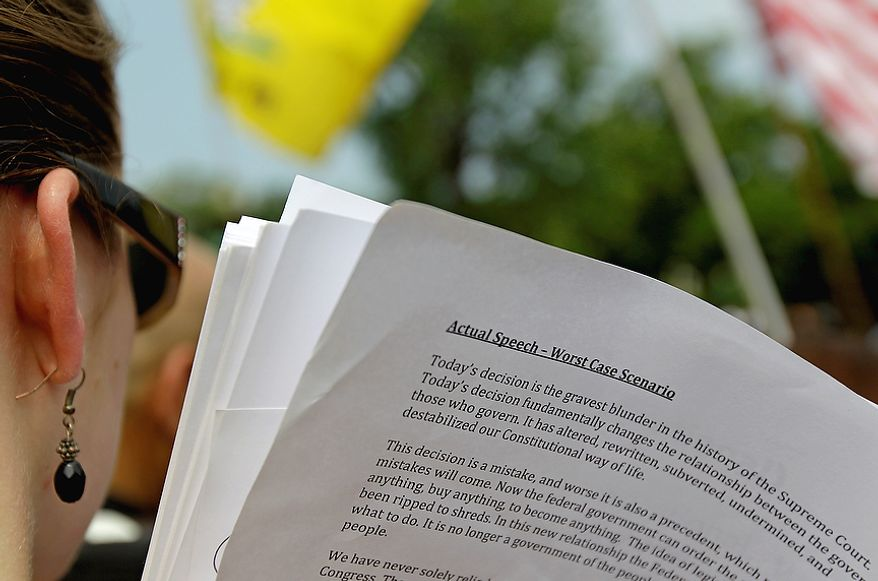A copy of a prepared speech is seen as Rep. Michele Bachmann, R-Minn, not pictured, speaks outside the Supreme Court in Washington, Thursday, June 28, 2012, after the court's ruling on President Barack Obama's health care law was announced. AP Photo/David Goldman)