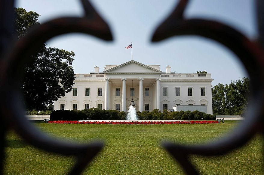 ** FILE ** The White House is seen in Washington, Thursday, June 28, 2012, after the Supreme Court ruled on President Barack Obama's health care legislation. (AP Photo/Pablo Martinez Monsivais)
