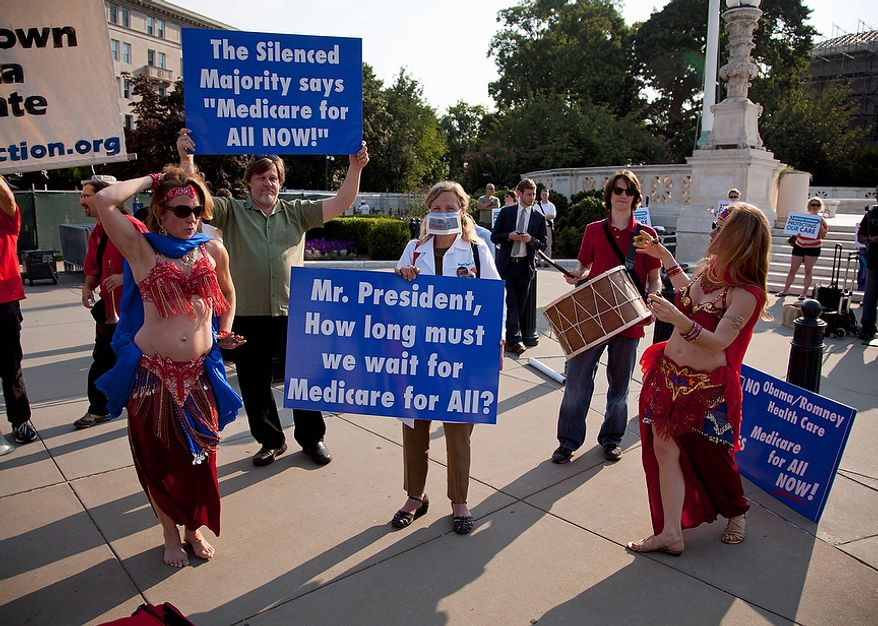 A group of belly dancers in favor of Medicare for all perform outside the Supreme Court in Washington, Thursday, June 28, 2012, before a landmark decision on health care.  (AP Photo/Evan Vucci)