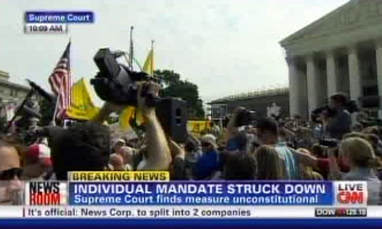 This television frame grab shows CNN broadcasting the Supreme Court's decision incorrectly on President Barack Obama's health care law on Thursday, June 28, 2012. Both CNN and Fox News Channel incorrectly reported Thursday that the law's central provision, requiring virtually all Americans to have health insurance, had been struck down. Both networks backtracked when it became clear that the court upheld the provision. (AP Photo)