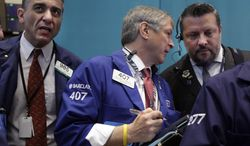 Traders work on the floor of the New York Stock Exchange on June 28, 2012. (Associated Press)