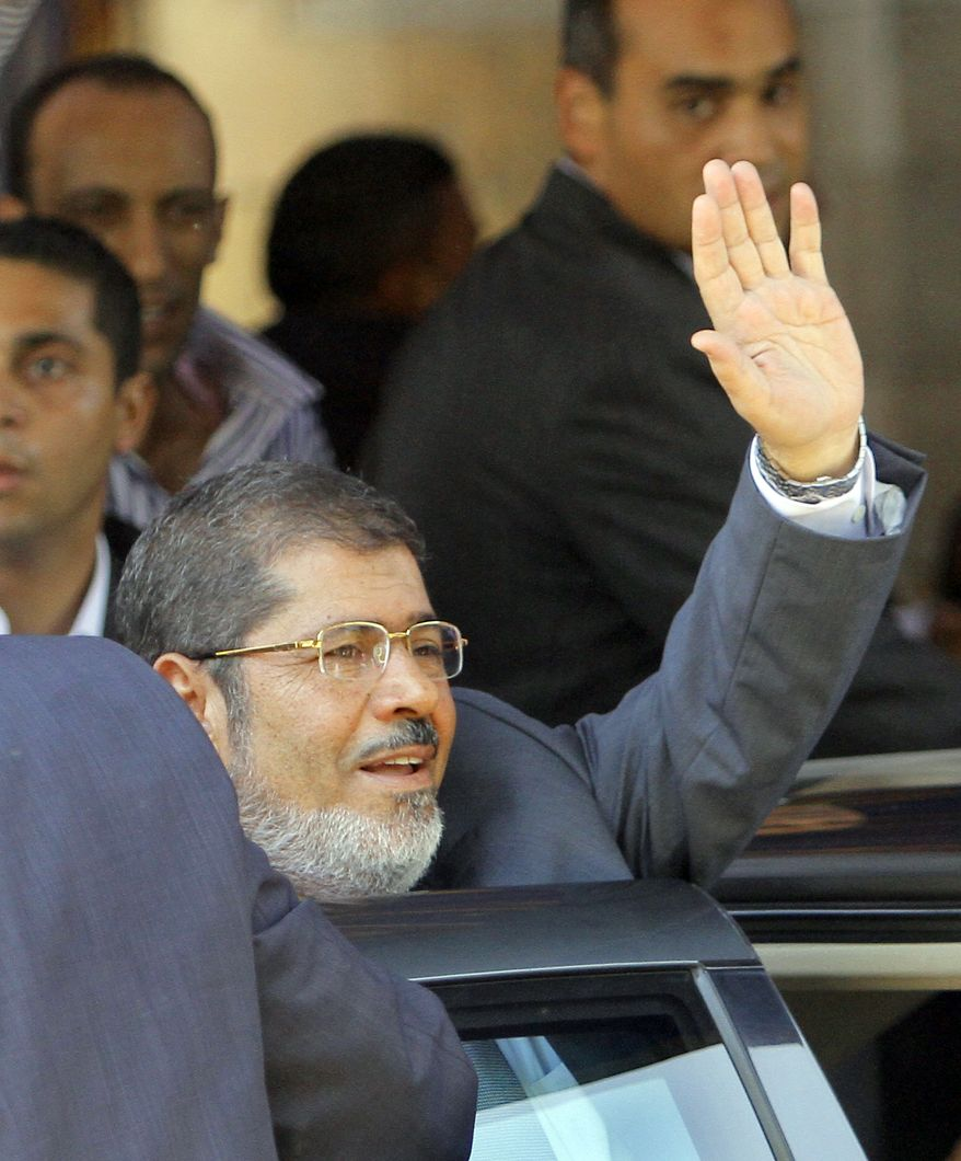 Mohammed Morsi, Egypt's president-elect, waves June 29, 2012, to his supporters following Friday prayers at Al-Azhar mosque in Cairo. Morsi was declared Egypt's first freely elected president in modern history five days earlier. (Associated Press)