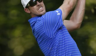 Hunter Mahan hits from the 13th tee during the second round of the AT&T National at Congressional Country Club in Bethesda, Md., on Friday, June 29, 2012. (AP Photo/Patrick Semansky)