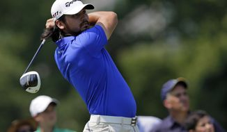 Jason Day watches his drive from the ninth tee during the first round of the AT&T National golf tournament at Congressional Country Club in Bethesda, Md., on Thursday, June 28, 2012. (AP Photo/Patrick Semansky)