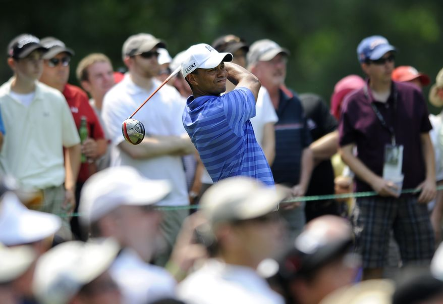 Tiger Woods watches his drive from the fourth tee during the second round of the AT&T National at Congressional Country Club in Bethesda, Md., on Friday, June 29, 2012. (AP Photo/Nick Wass)