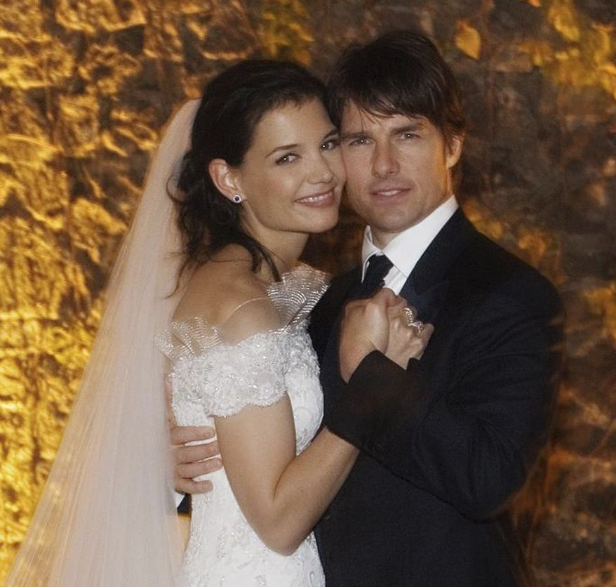 ** FILE ** In this Nov. 18, 2006, file photo released by Rogers and Cowan, actor Tom Cruise and actress Katie Holmes pose in their wedding attire at the 15th-century Odescalchi Castle overlooking Lake Bracciano outside of Rome. Cruise and Homes are calling it quits after five years of marriage. (AP Photo/Robert Evans, File)