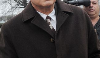 **FILE** Peter Madoff exits State Supreme Court in Mineola, N.Y., on April 3, 2009. (Associated Press)