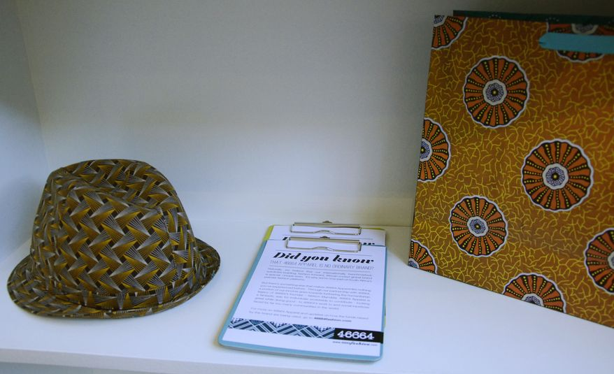 A hat and purse, part of a fashion label inspired by former South African President Nelson Mandela, are displayed June 29, 2012, in Johannesburg. (Associated Press)