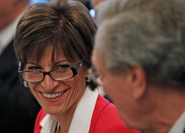 University of Virginia Rector Helen Dragas smiles as she talks with Board of Visitors member W. Haywood Fralin during a meeting in the Rotunda at the school on Tuesday, June 26, 2012, in Charlottesville, Va. (AP Photo/Steve Helber)