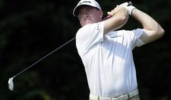 Robert Garrigus watches his drive from the fifth tee during the third round of the AT&T National golf tournament at Congressional Country Club in Bethesda, Md., Saturday, June 30, 2012. (AP Photo/Patrick Semansky)