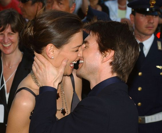 ** FILE ** In this Friday April 29, 2005, file photo, Tom Cruise, right, and Katie Holmes laugh as they stroll on Via della Conciliazione Boulevard near St. Peter's Basilica, in Rome. Holmes' attorney Jonathan Wolfe said Friday June 29, 2012, that the couple is divorcing, but called it a private matter for the family. (AP Photo/Corrado Giambalvo, File)