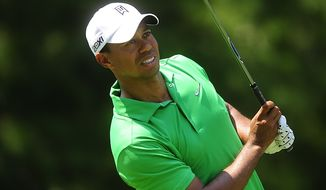 Tiger Woods reacts to a shot at Congressional Country Club during third round play of the AT&T National golf tournament, Bethesda, Md., Saturday, June 30, 2012.  (Ryan M.L. Young/The Washington Times)
