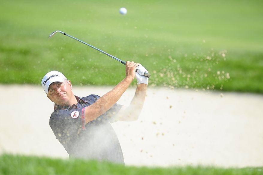 Bo Van Pelt hits from the bunker at Congressional Country Club during third round play of the AT&T National golf tournament, Bethesda, Md., Saturday, June 30, 2012.  (Ryan M.L. Young/The Washington Times)