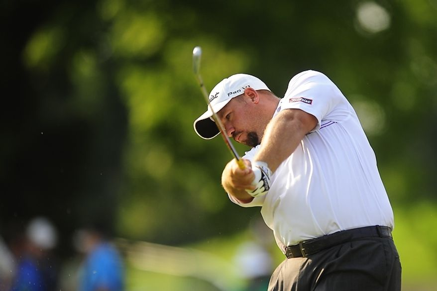 Brendon de Jonge tees off on the tenth hole at Congressional Country Club during third round play of the AT&T National golf tournament, Bethesda, Md., Saturday, June 30, 2012.  (Ryan M.L. Young/The Washington Times)