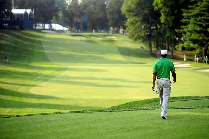 Tiger Woods walks down the fifteenth fairway at Congressional Country Club during third round play of the AT&T National golf tournament, Bethesda, Md., Saturday, June 30, 2012.  The tournament was closed to the public on Satur