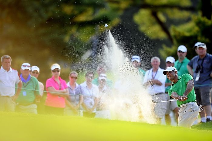 Tiger Woods hits from the bunker on the sixteenth hole at Congressional Country Club during third round play of the AT&T National golf tournament, Bethesda, Md., Saturday, June 30, 2012.  (Ryan M.L. Young/The Washington Times)