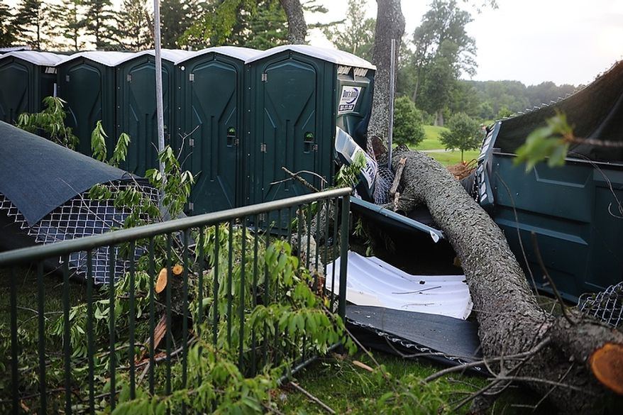 Fallen trees caused a great deal of damage at Congressional Country Club during third round play of the AT&T National golf tournament, Bethesda, Md., Saturday, June 30, 2012.  The tournament was closed to the public on Saturday due to storms the previous night causing severe damage throughout the course.  (Ryan M.L. Young/The Washington Times)