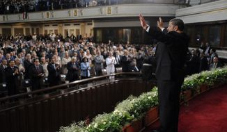 In this image released by the Egyptian Presidency, Egyptian President Mohammed Morsi waves to guests after giving an inaugural address at Cairo University in Cairo, Egypt, Saturday, June 30, 2012. (AP Photo/Mohammed Abd El-Maaty, Egyptian Presidency)
