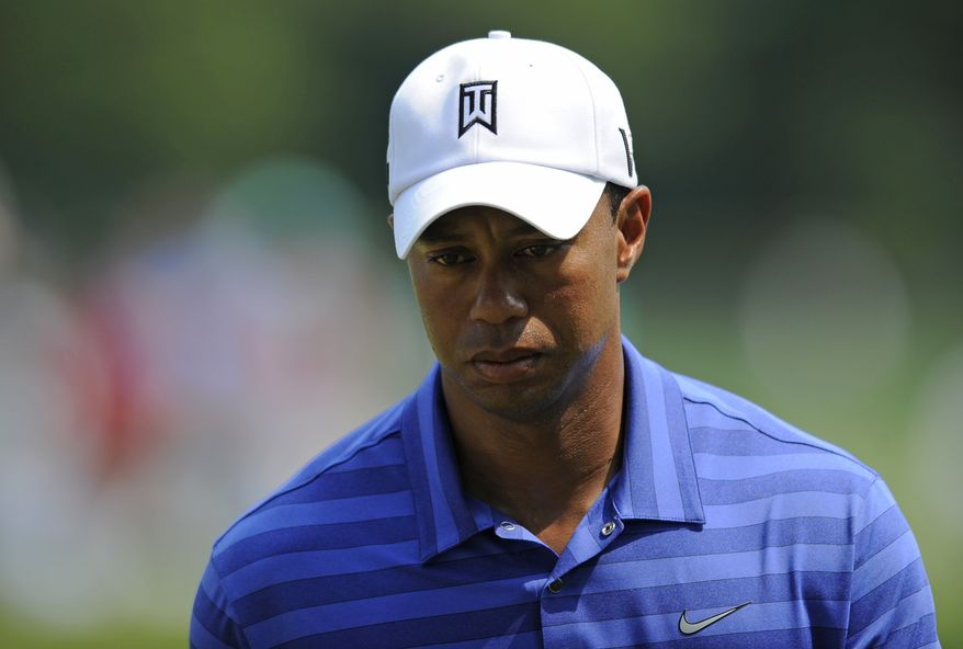 Tiger Woods walks on the third green during the second round of the AT&T National golf tournament at Congressional Country Club in Bethesda, Md., Friday, June 29, 2012. (AP Photo/Nick Wass)