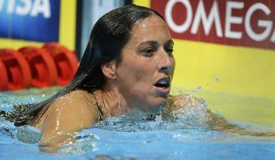 Janet Evans leaves her lane after swimming in the women's 800-meter freestyle preliminaries at the U.S. Olympic trials on Saturday, June 30, 2012, in Omaha, Neb. (AP Photo/Mark Humphrey)