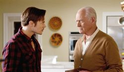 """""""Dallas"""" newcomer Josh Henderson and original cast member Larry Hagman will be at Southfork for at least another season, according to TNT. (TNT via Associated Press)"""