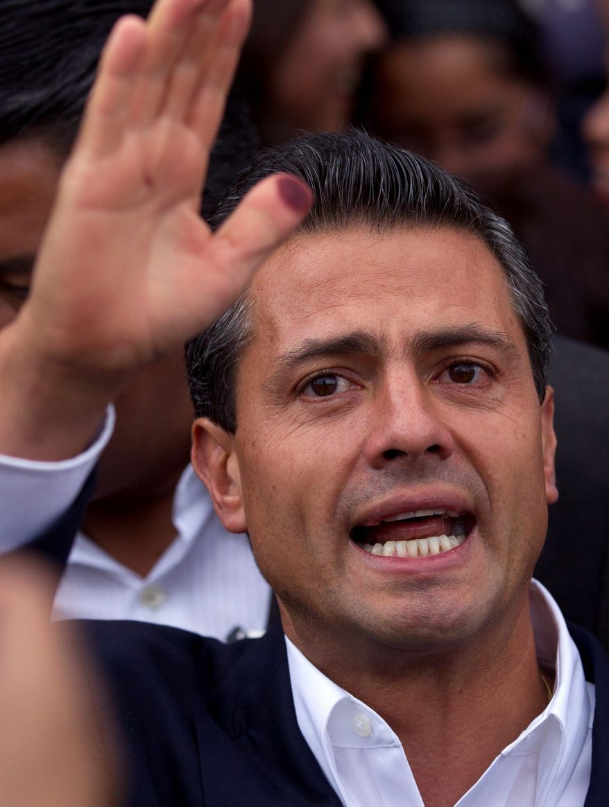 Enrique Pena Nieto of the Revolutionary Institutional Party held a significant lead for president as voting was under way Sunday in Mexico's 31 states. His party controlled the Mexican presidency through much of the 20th century before losing the past two elections. (Associated Press)