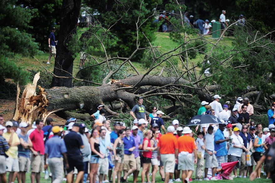 A downed tree provided the backdrop for the fifth fairway at Congressional Country Club during the final round of the AT&T National. Volunteers and spectators were kept away for Saturday's third round because of damage to the course from heavy storms in the region Friday night. (Ryan M.L. Young/The Washington Times)
