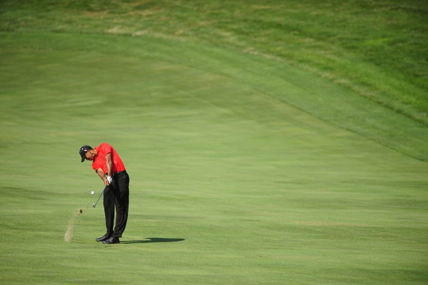 Tiger Woods hits an approach shot on the 14th hole at Congressional Country Club during final round play of the AT&T National golf tournament, Bethesda, Md., Sunday, July 1, 2012.  (Ryan M.L. Young/The Washington Times)
